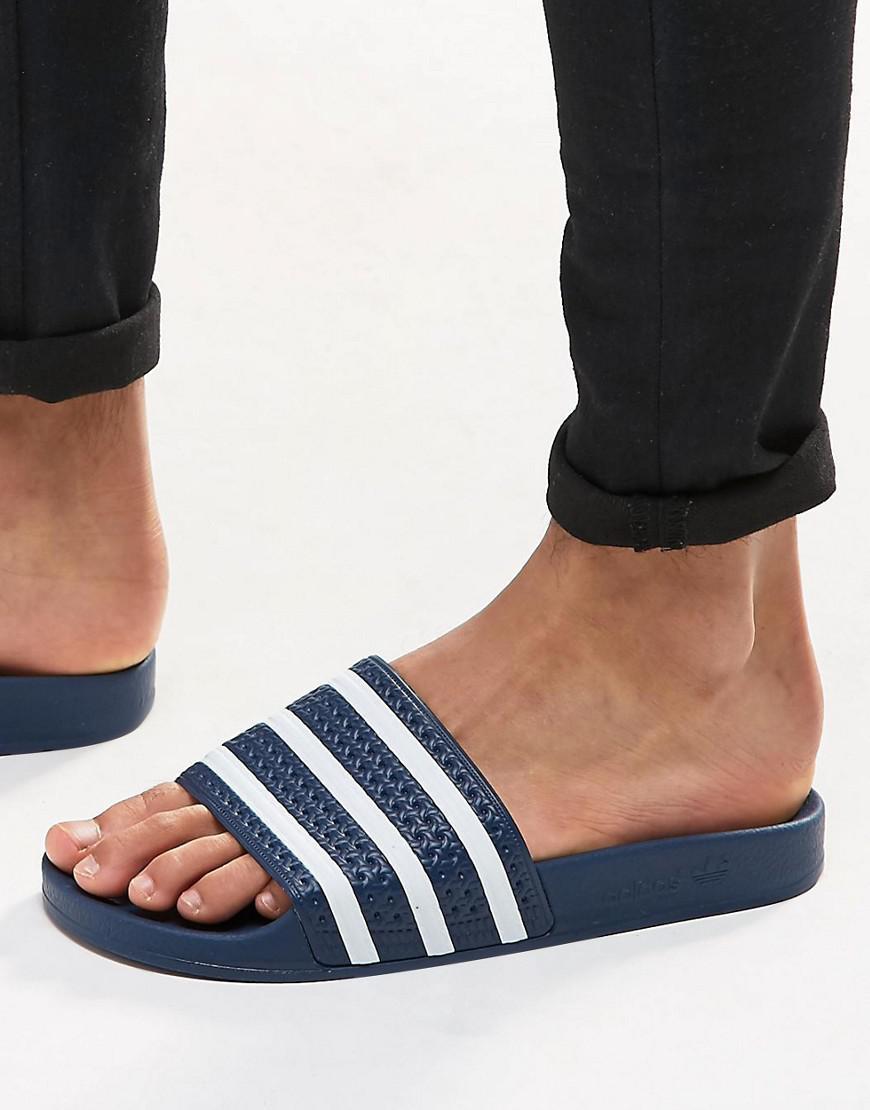 9517484ba adidas Originals Adilette Slider Flip Flops 288022 in Blue for Men ...