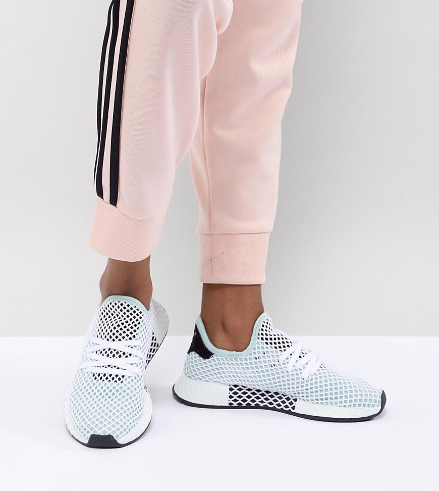 7acd48d05 adidas Originals Deerupt Runner Sneakers In Green in Black - Lyst