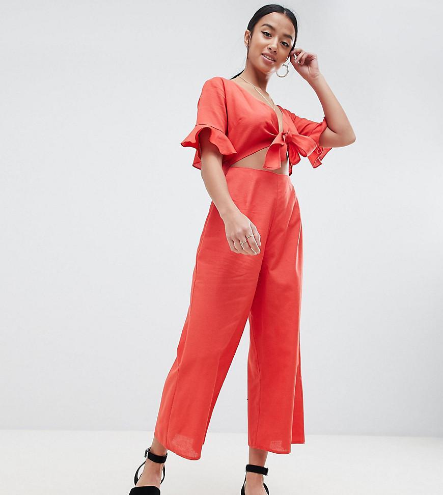 84c39b7fcb9 ASOS. Women s Black Asos Design Petite Tea Jumpsuit With Cut Out And Tie  Detail ...