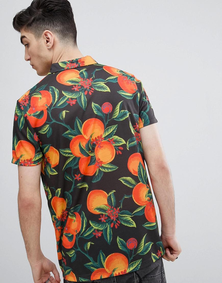 c04d7b86ad8 Lyst - Polo imprim fleurs et fruits avec col revers ASOS pour homme en  coloris Noir