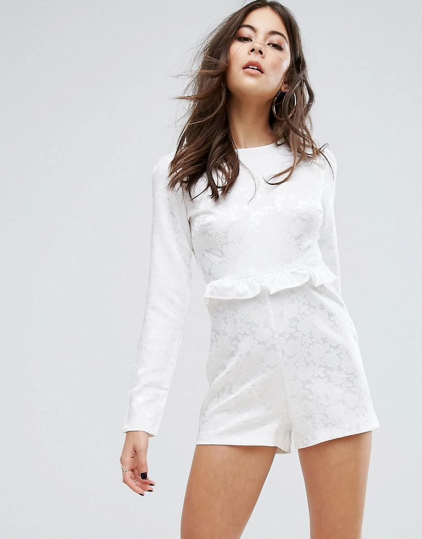 90382f587e7 Lyst - PrettyLittleThing Floral Ruffle Playsuit in White