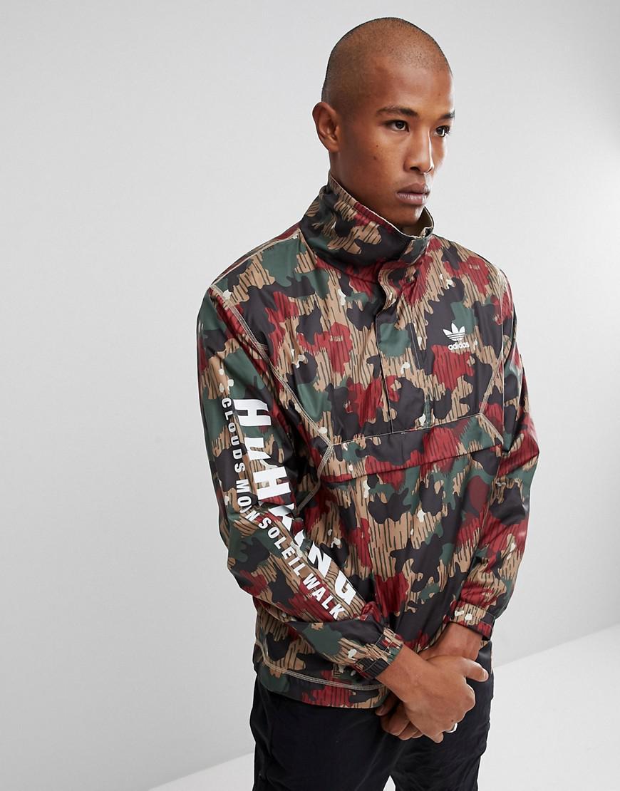 1ce18f6ca6 adidas Originals X Pharrell Williams Hu Hiking Half Zip Windbreaker ...