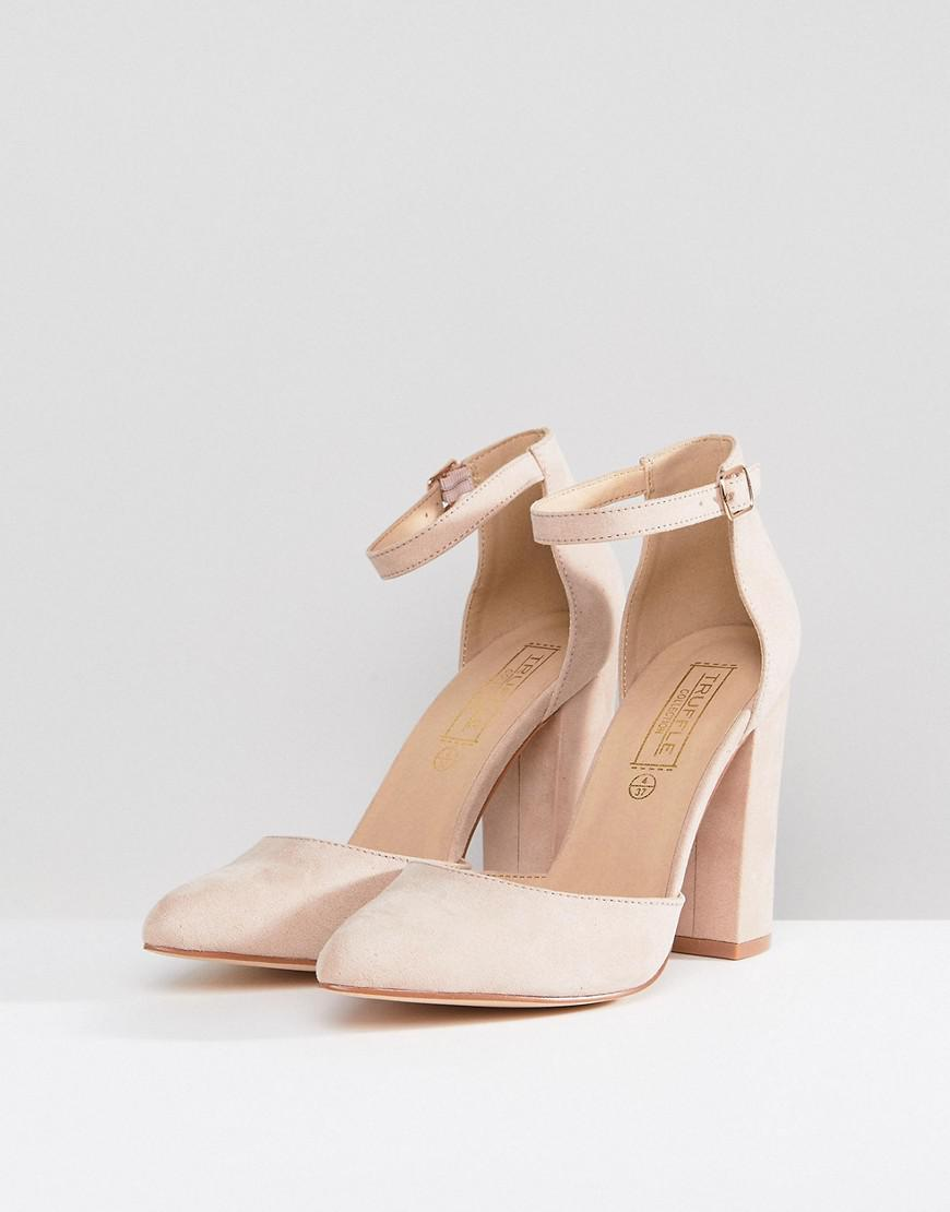 2be958db140 Truffle Collection Pointed Block Heels in Natural - Lyst