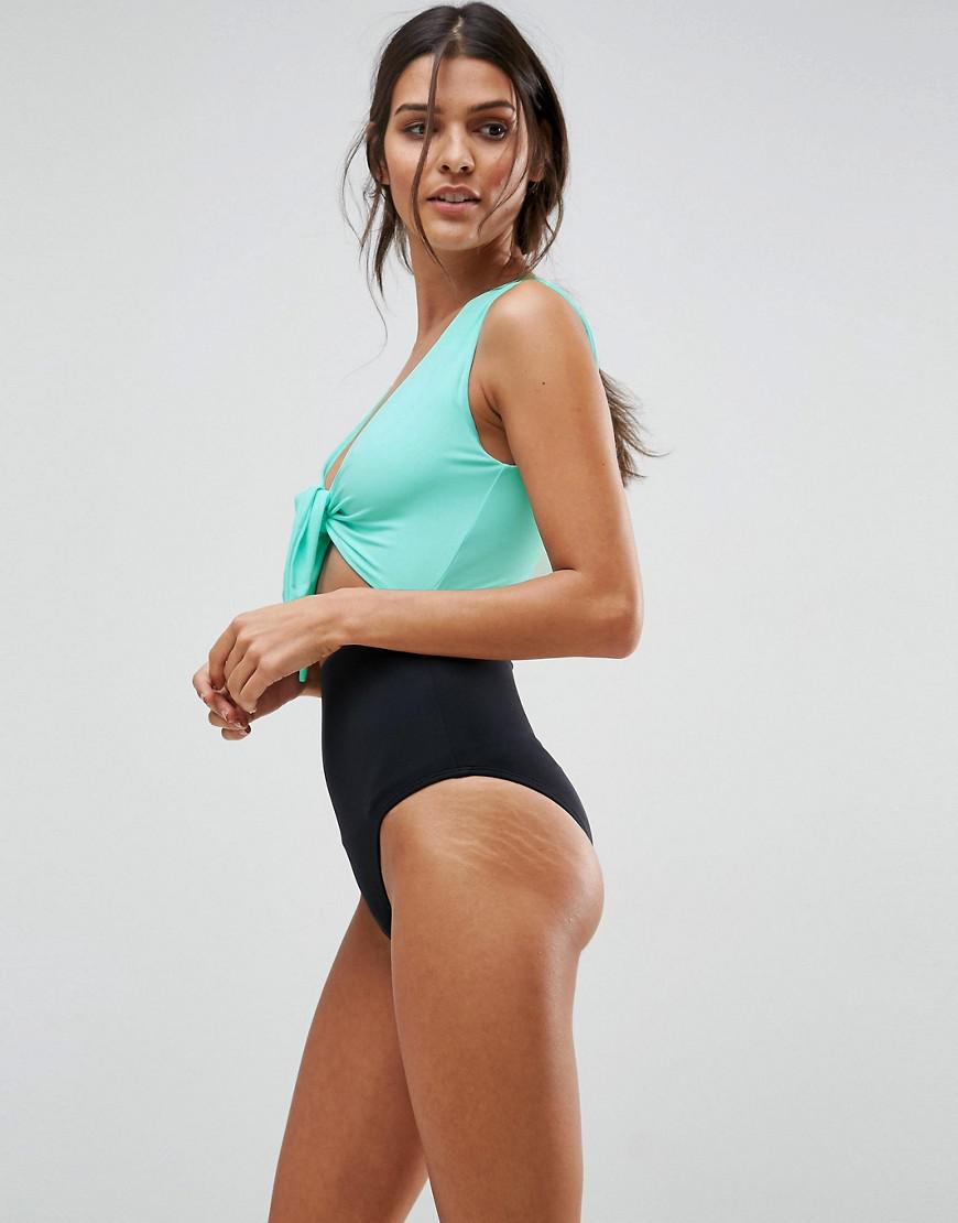 aa89550cdf4fc Lyst - ASOS Design Tie Front Cut Out Swimsuit in Green