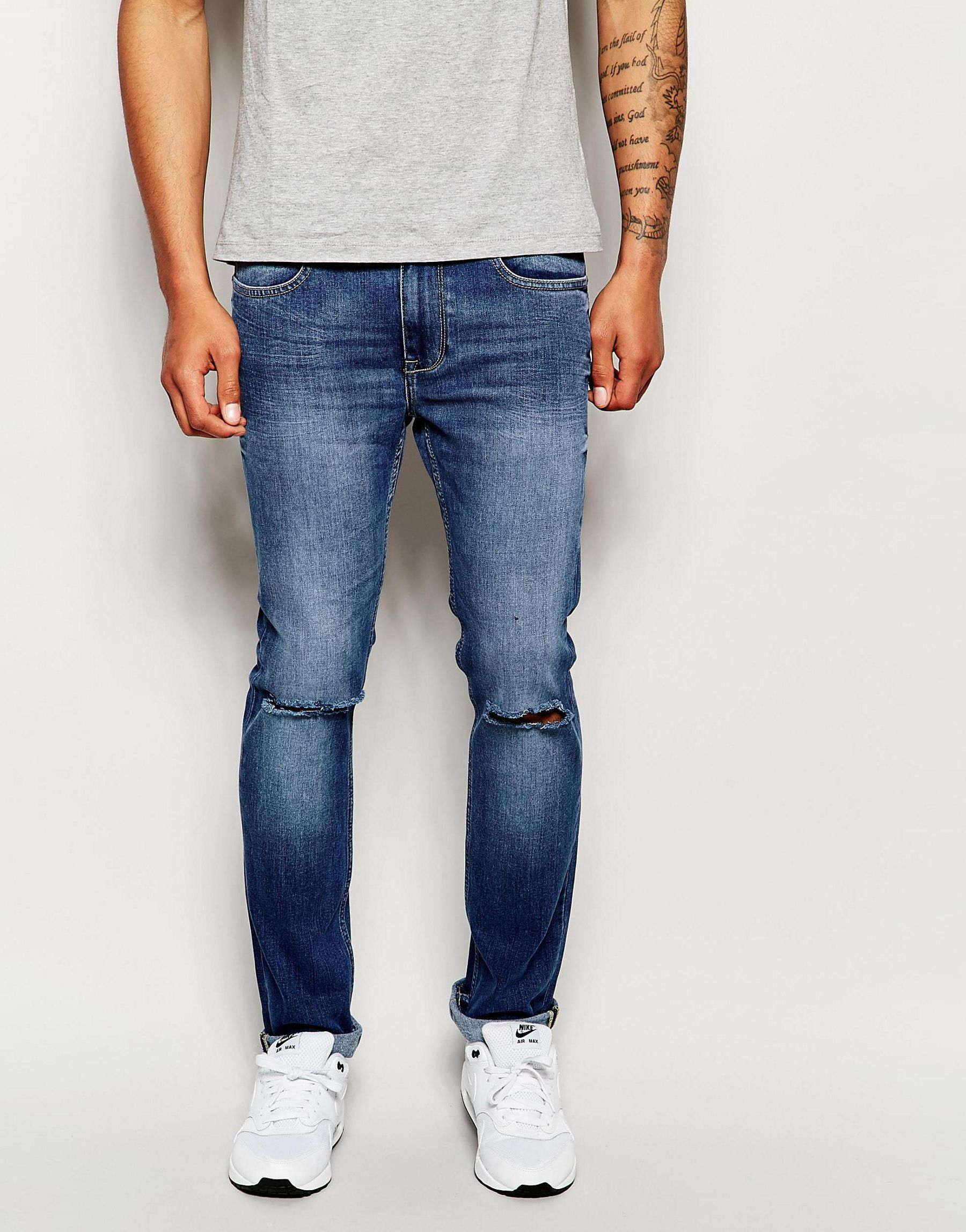 lyst dry cast skinny jean knee rip in blue for men