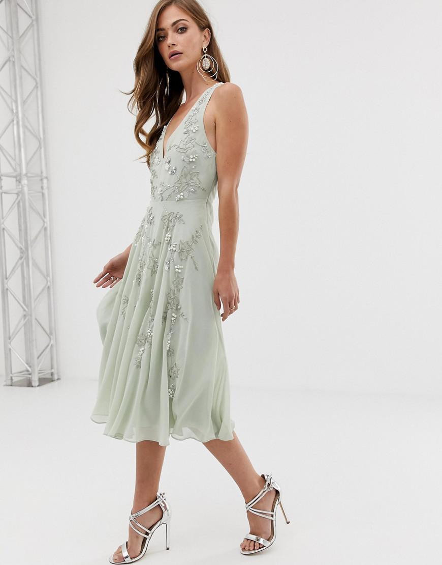 78e4065fe5056 Lyst - ASOS Twist Strap Pretty Pearl Embellished Midi Dress in Green