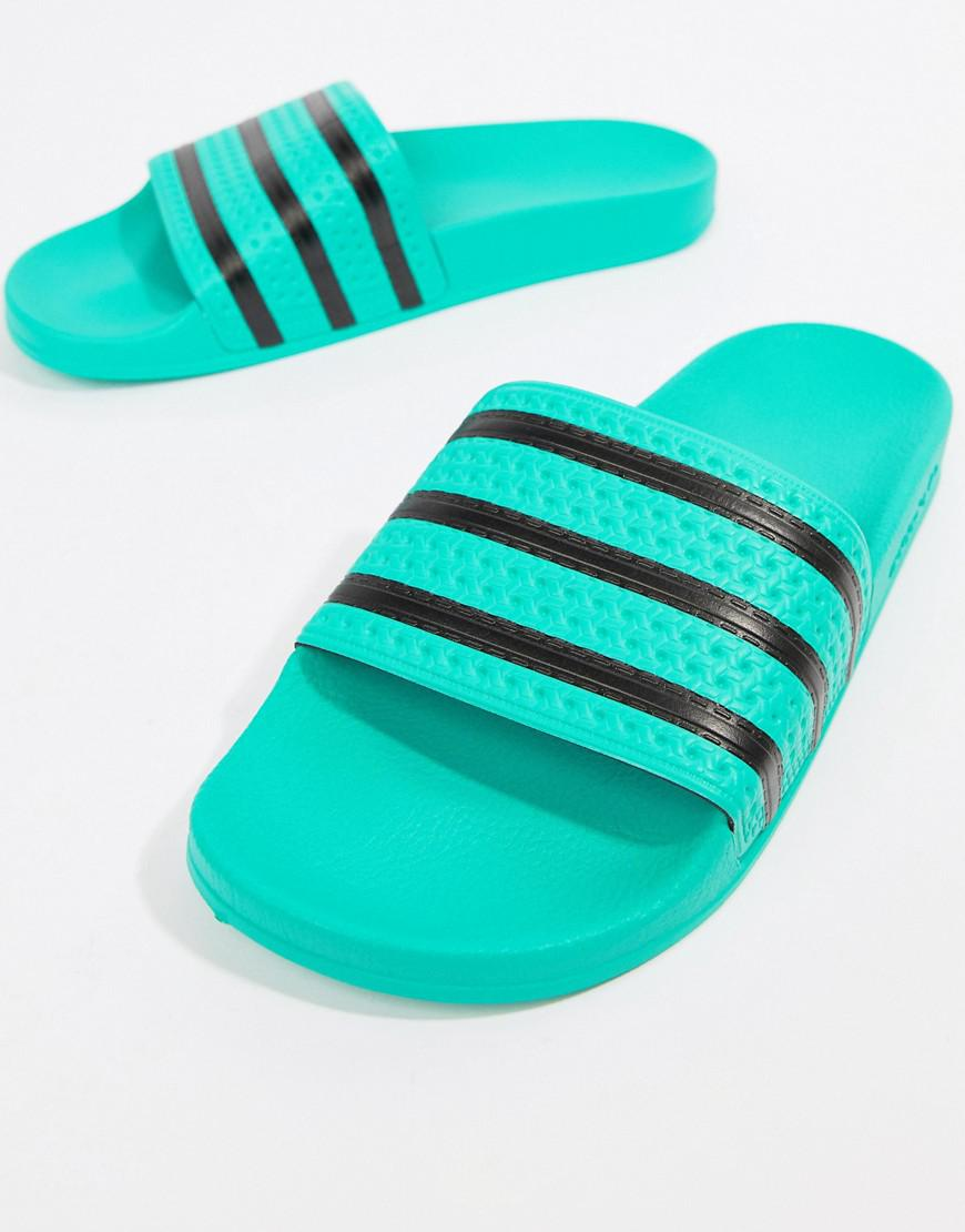 3ff268988ff88b Adidas Originals - Adilette Sliders In Green Cq3100 for Men - Lyst. View  fullscreen
