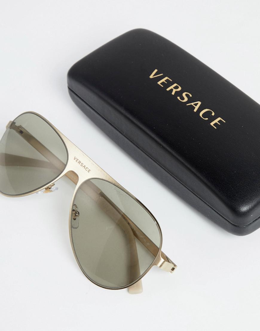 Lyst - Lunettes de soleil aviateur avec logo Versace pour homme en ... 459905bf218b