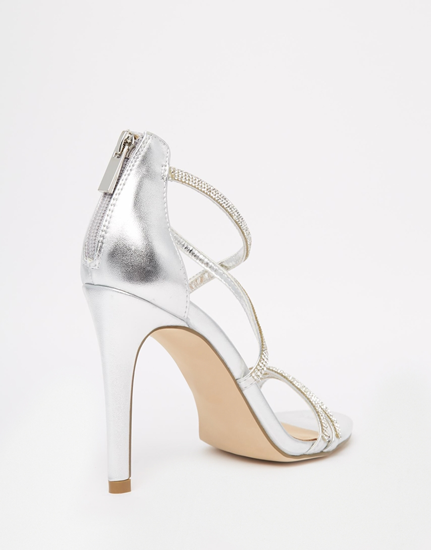 3d8c445461a Lyst - ALDO Arenani Silver Cross Front Heeled Sandals in Metallic