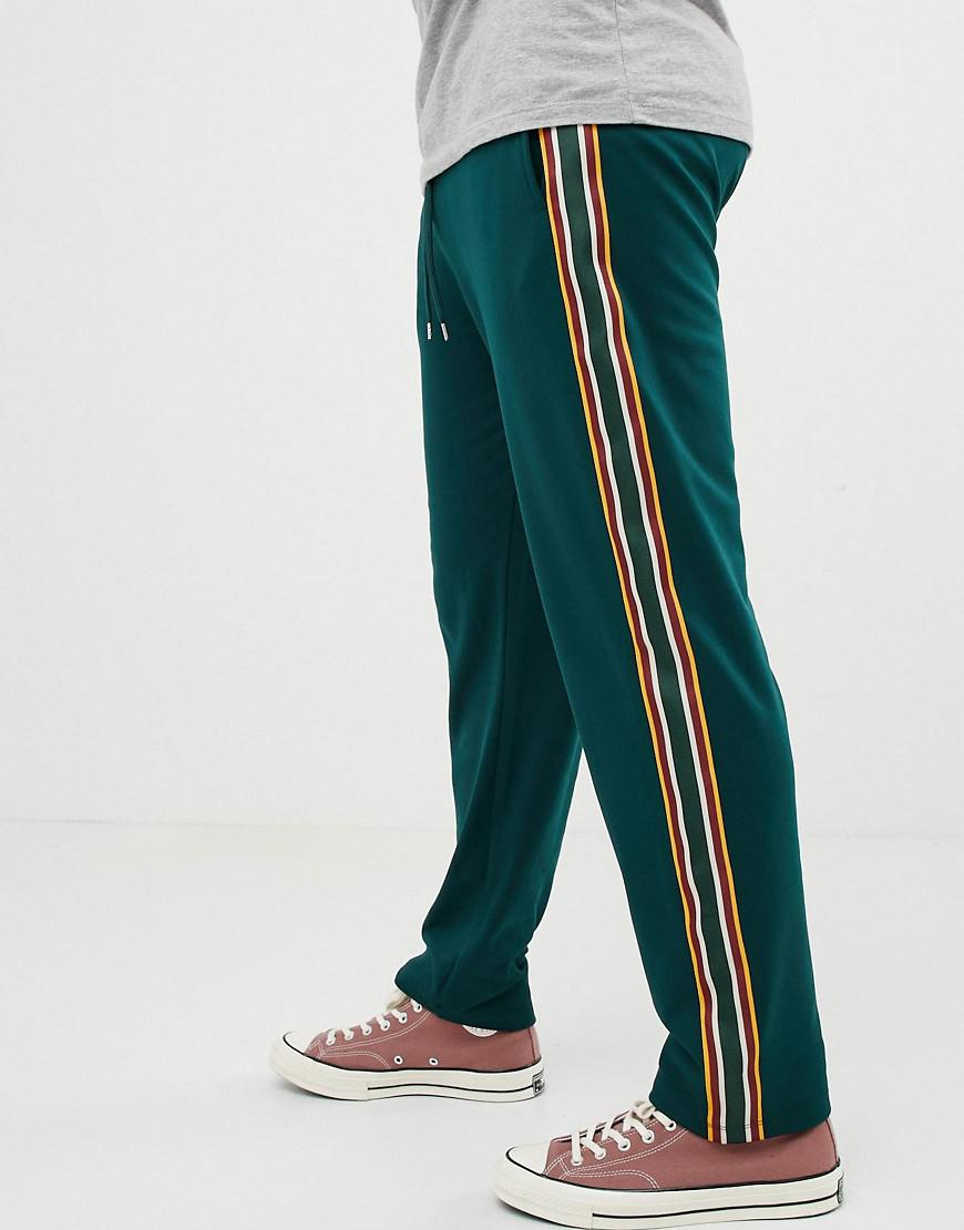 daa8eeb82d7 ASOS Retro Track Tapered joggers With Side Stripes in Green for Men ...