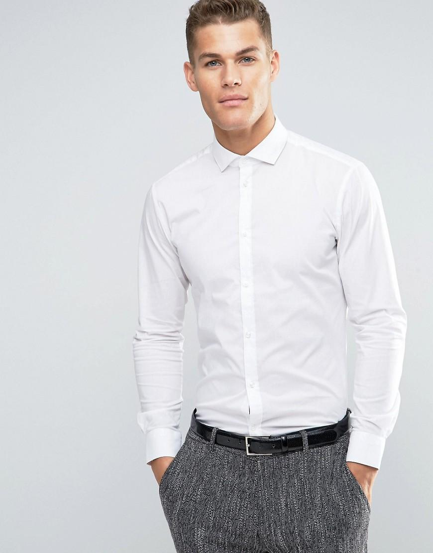 """Debrett's: """"For men, formal smart casual requires a jacket or blazer, flannels, needlecord trousers or chinos, a shirt with a collar, and smart shoes – not trainers or sandals. A sweater may."""