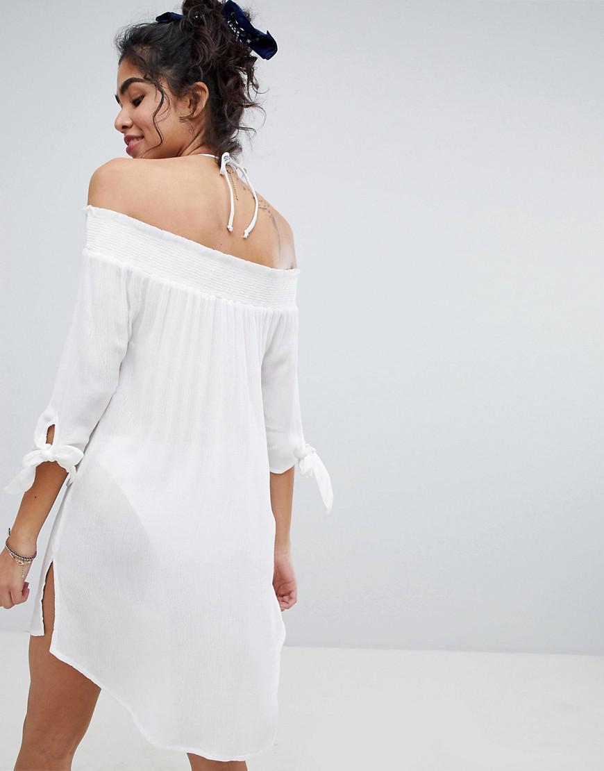 51675d3ea9510 ... White Shirred Bardot Beach Dress - Lyst. View fullscreen