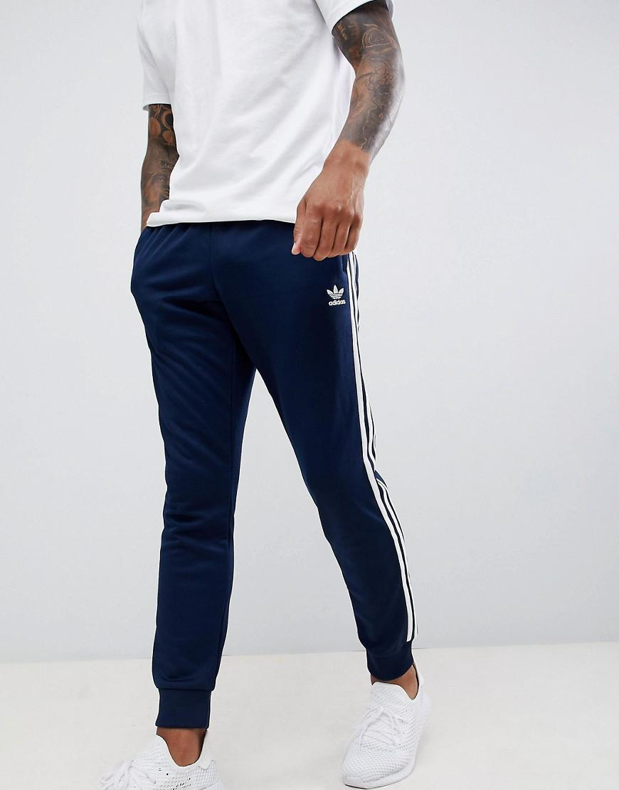 Lyst - adidas Originals 3-stripe Skinny joggers With Cuffed Hem In Navy  Dh5834 in Blue for Men d5cd47d5d703