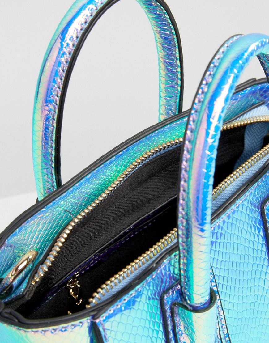 57198537c Skinnydip London Mini Cosmo Iridescent Tote Bag in Blue - Lyst