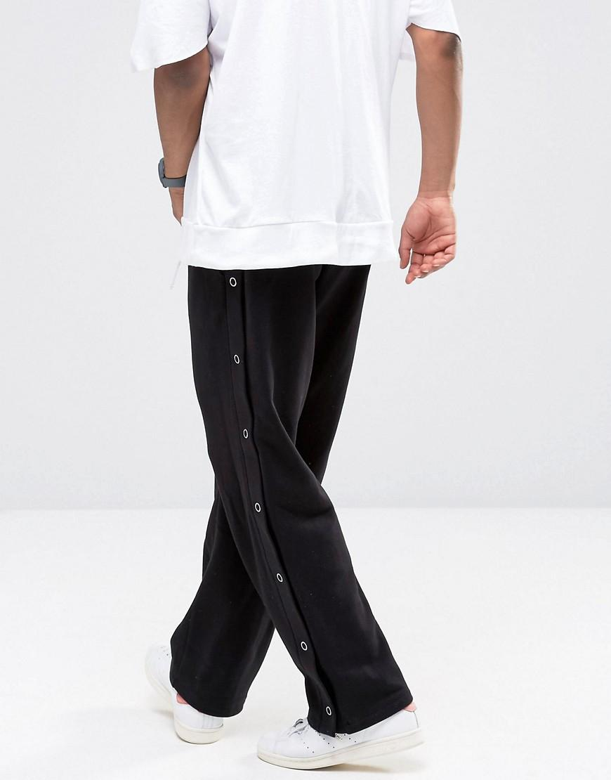 lyst asos straight leg joggers with side poppers in. Black Bedroom Furniture Sets. Home Design Ideas