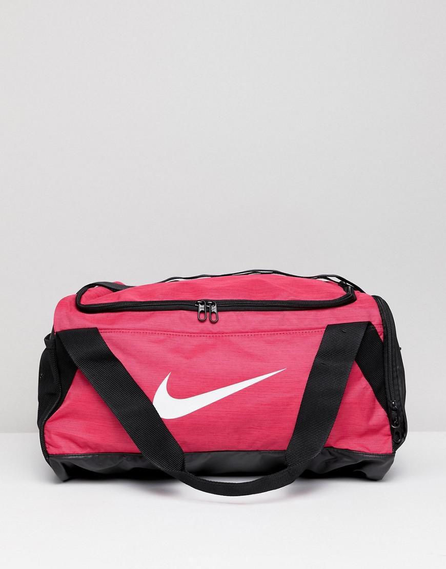 976127b33f Nike Pink Swoosh Logo Duffle Bag in Pink - Lyst