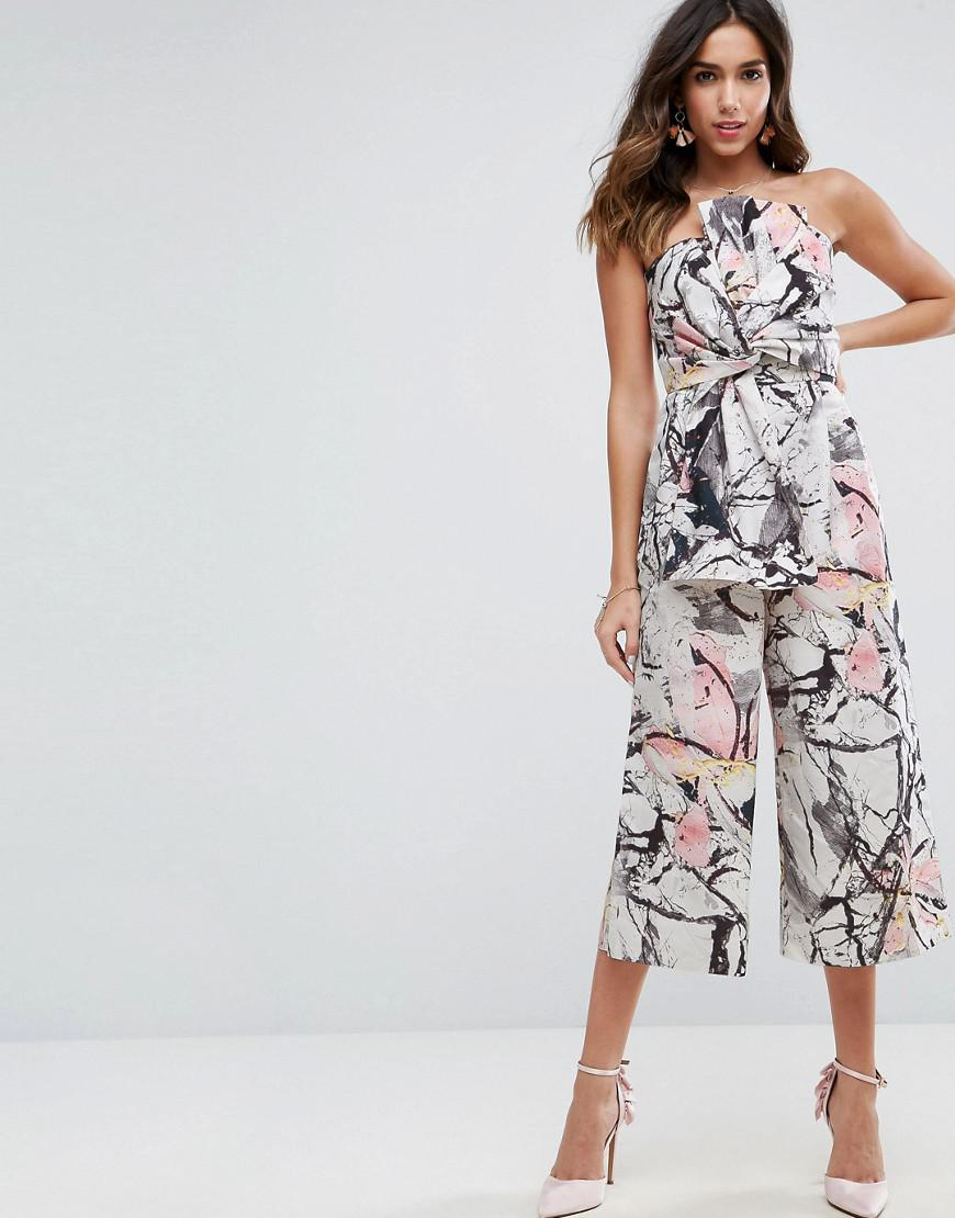 086798628bb Lyst - ASOS Floral Abstract Jumpsuit In Structured Fabric With Knot ...