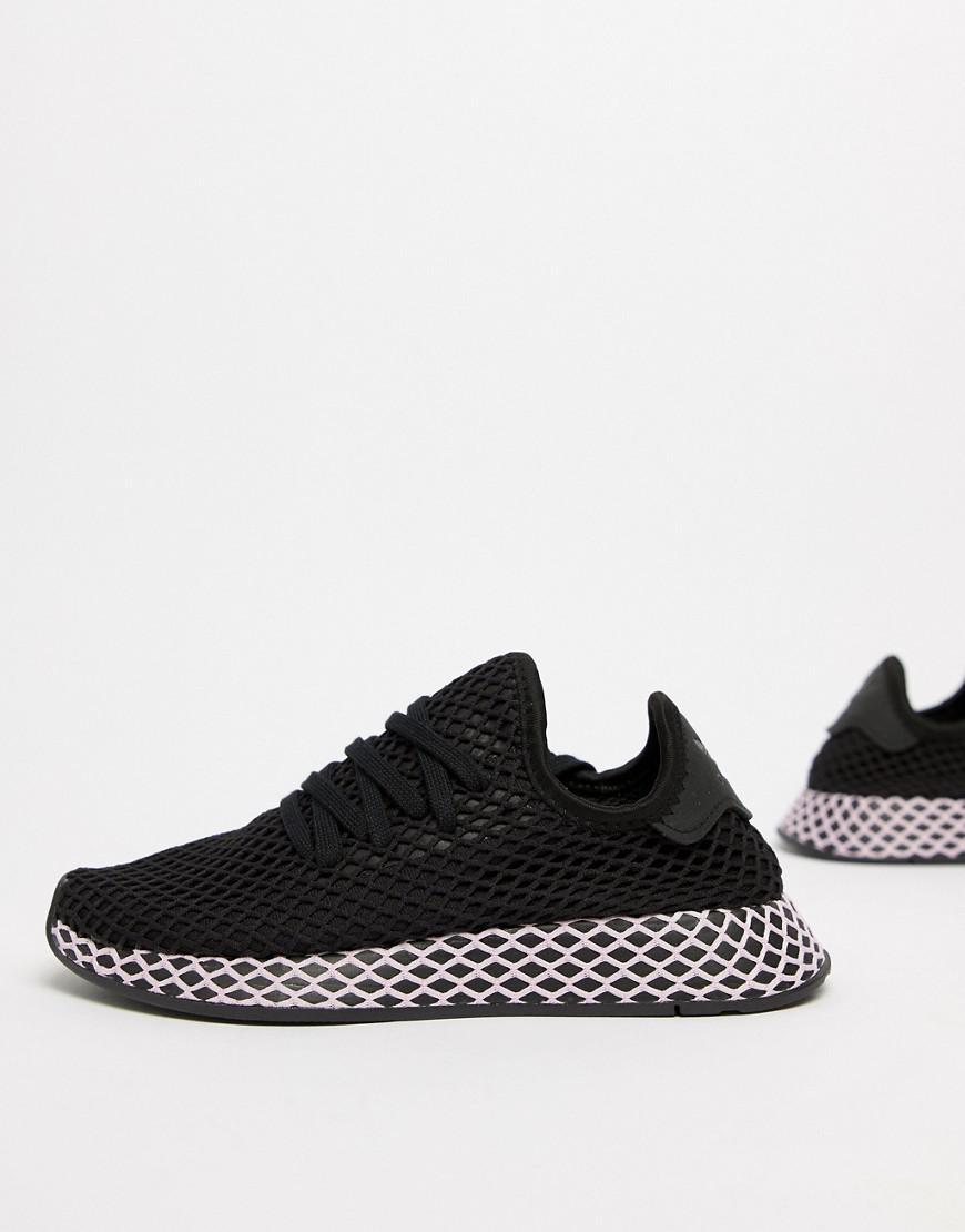 Adidas originali deerupt formatori in nero e lilla in nero lyst