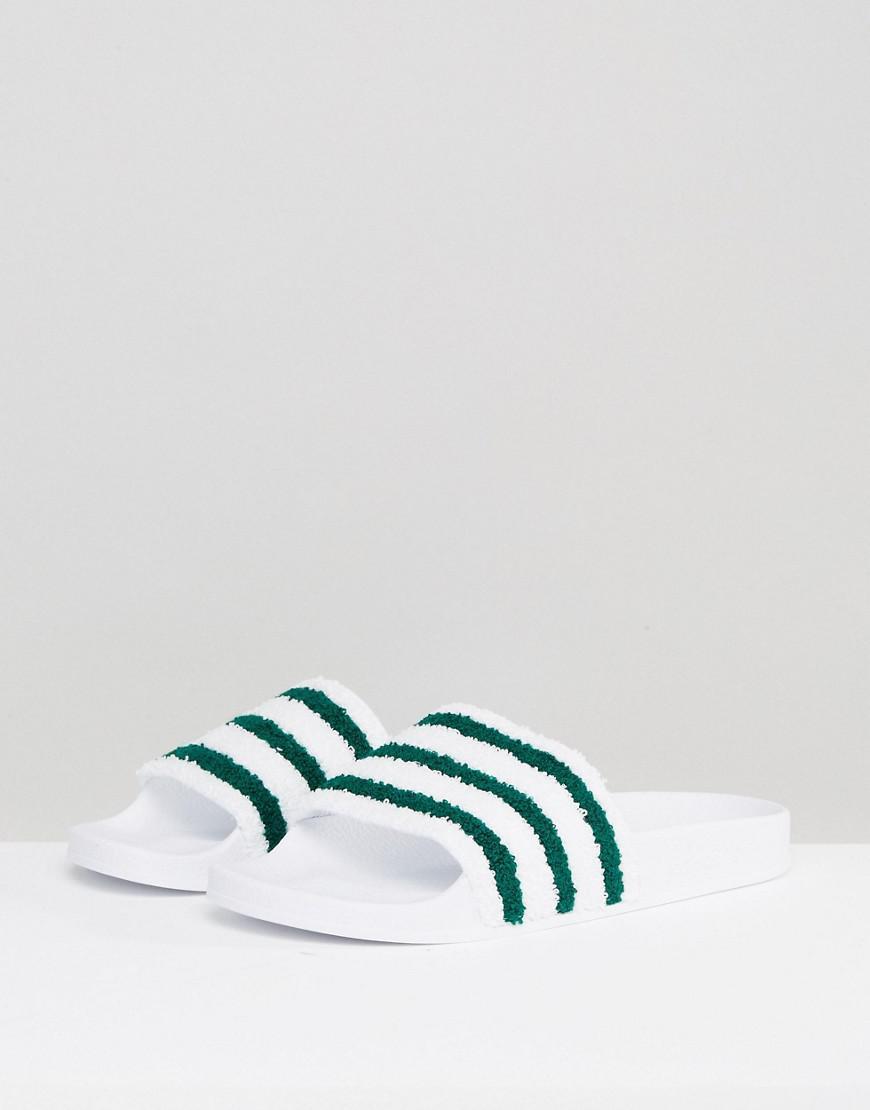 8cf8eaee86e39 adidas Originals Adilette Slides In White Bb0124 in White for Men - Lyst