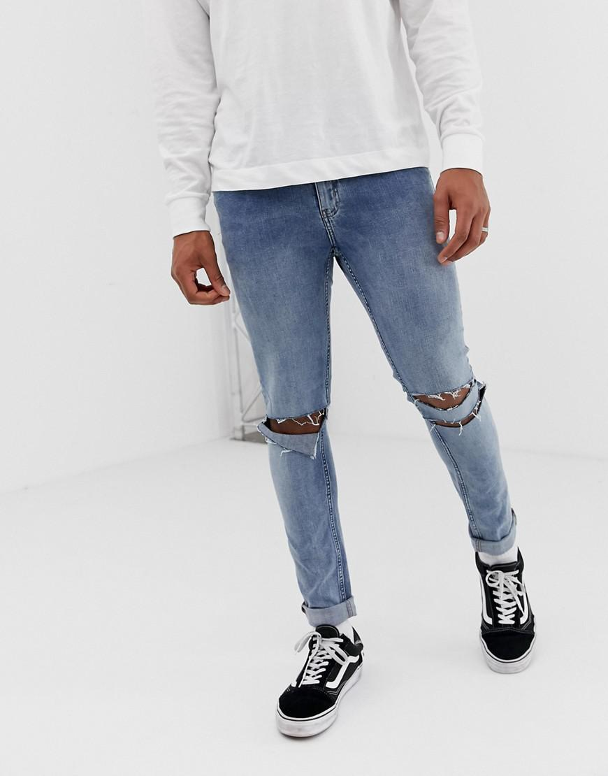 5439a903981 Cheap Monday. Men's Skinny Tight Jeans In Sacred Blue With Knee Rips
