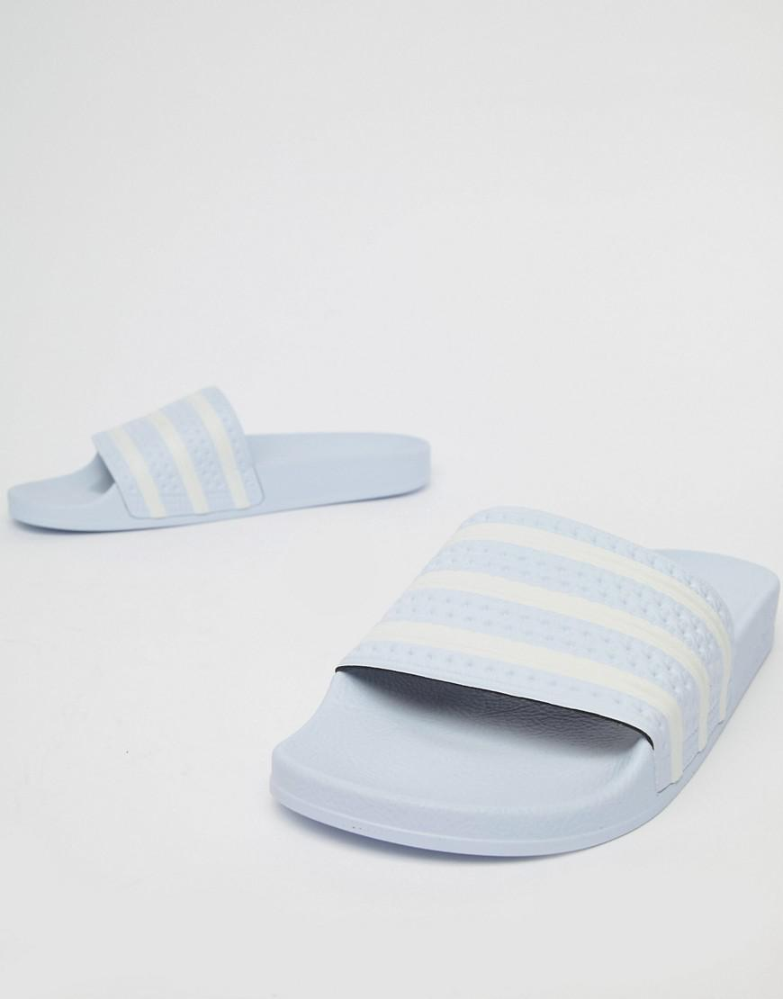 1b6c334d0 adidas Originals Adilette Sliders In Blue B41546 in Blue for Men - Lyst