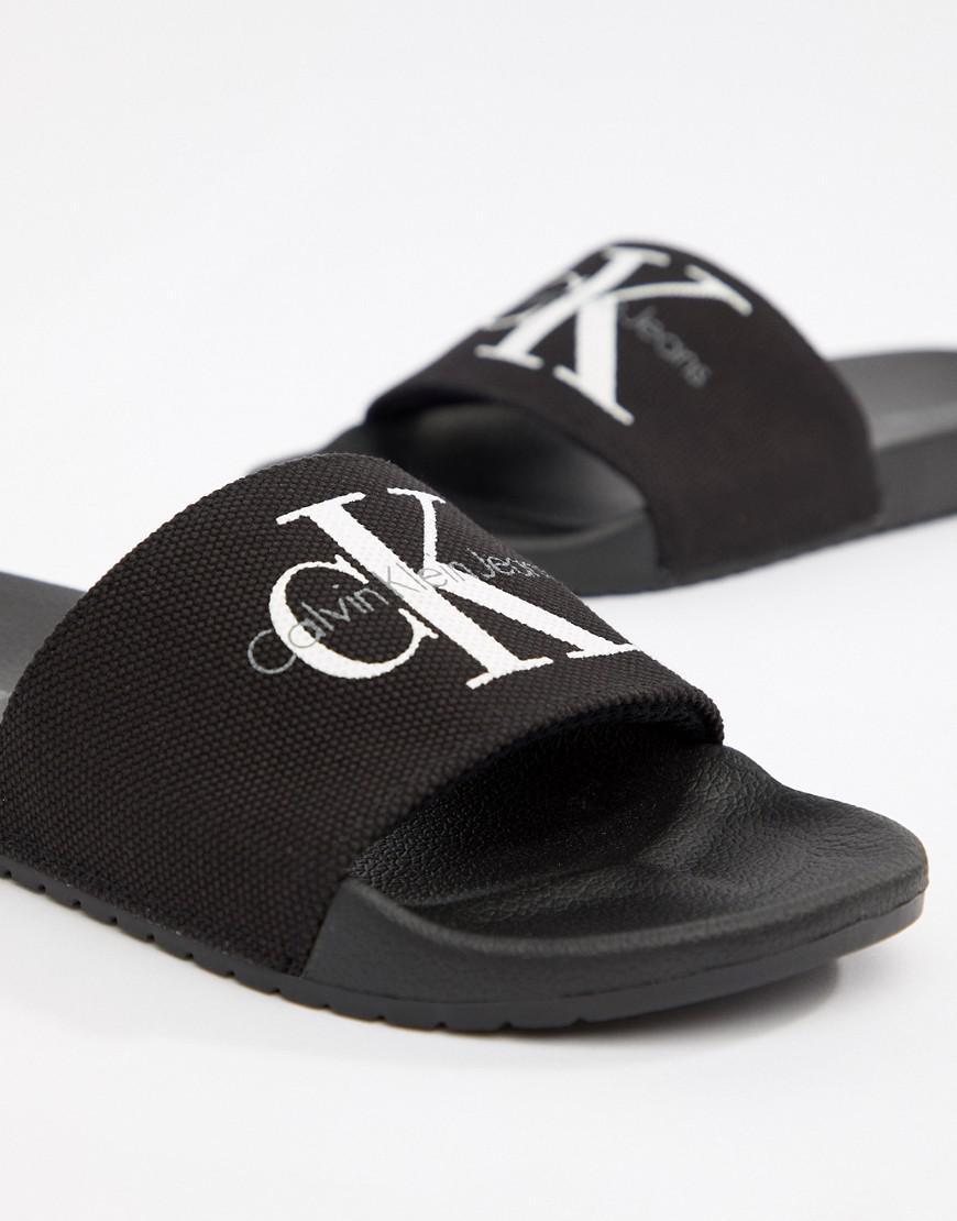 fbe30ba0699c Calvin Klein Viggo Logo Sliders In Black in Black for Men - Save 3% - Lyst