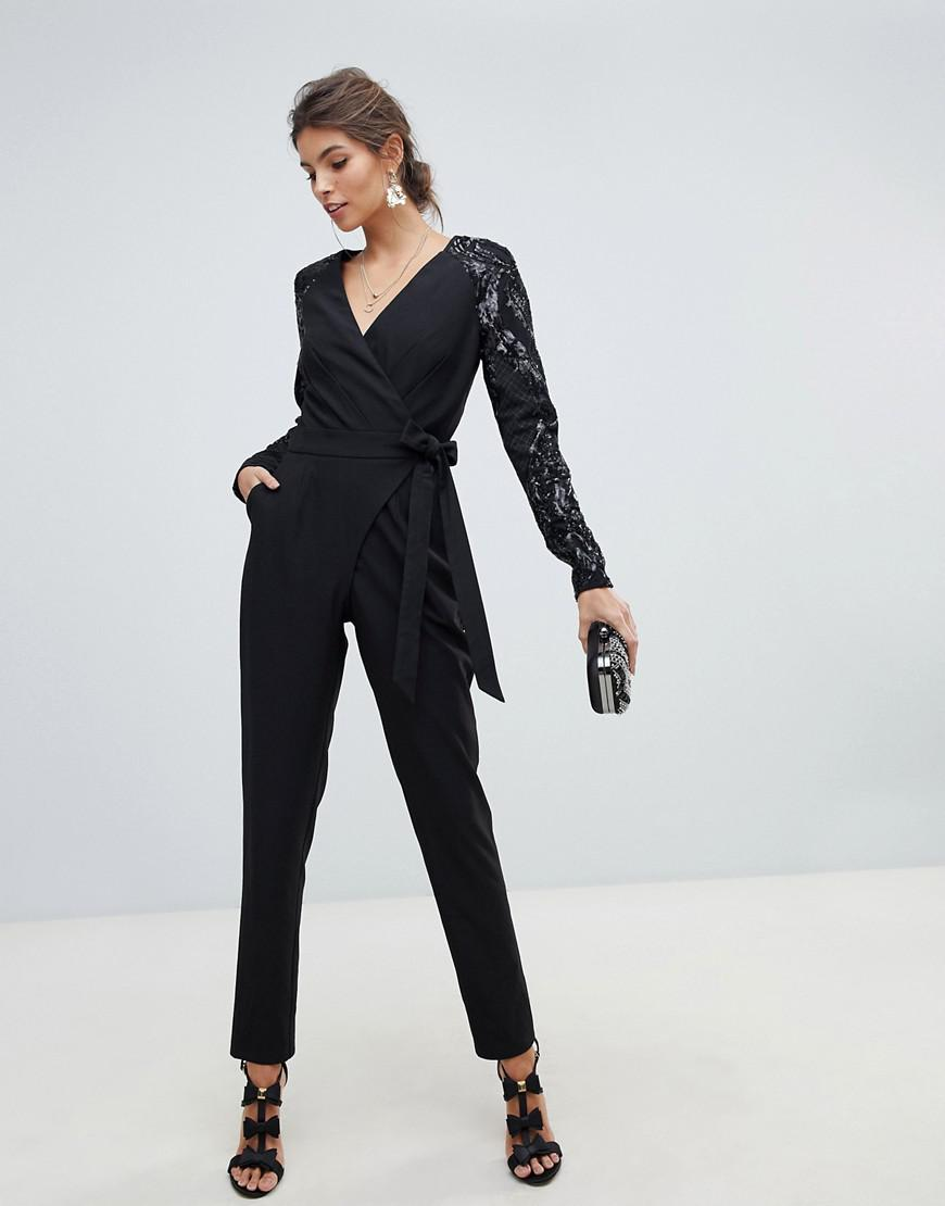 b042c08aad3b Little Mistress Wrap Front Jumpsuit With Sequin Sleeves And Exposed ...