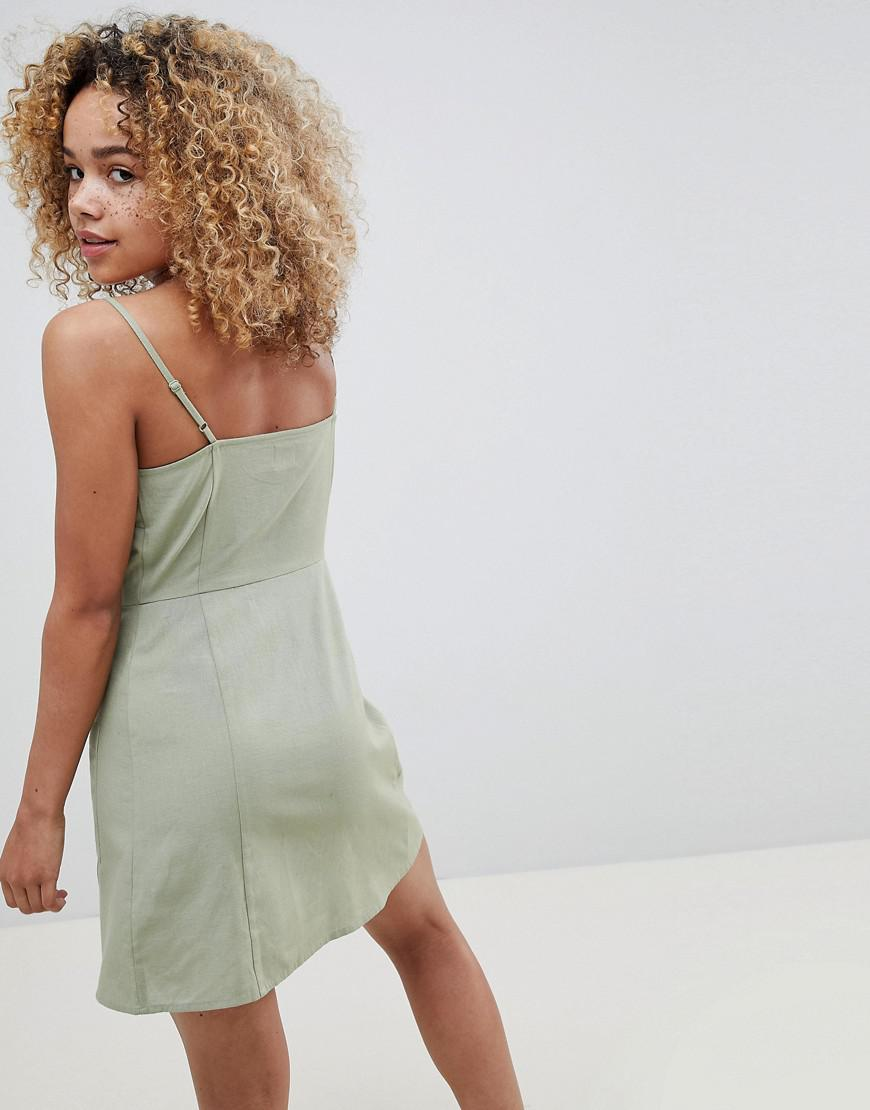 7105c953c2f Lyst - ASOS Asos Design Petite Button Through Linen Mini Sundress in ...