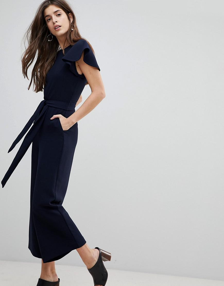 db4a733519c1 Lyst - Warehouse Frill Sleeve Belted Jumpsuit in Blue