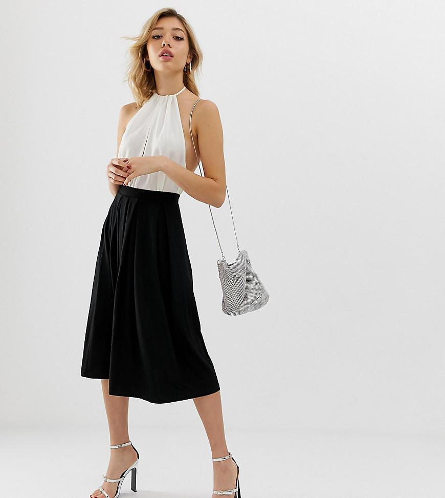 7f1bdb9872 Lyst - Falda midi con pliegues de ASOS DESIGN Petite ASOS de color Negro