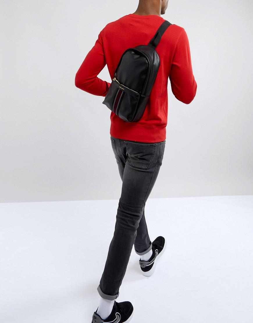 cd8f3b7099 Asos Cross Body Backpack In Black Faux Leather With Front Pocket ...