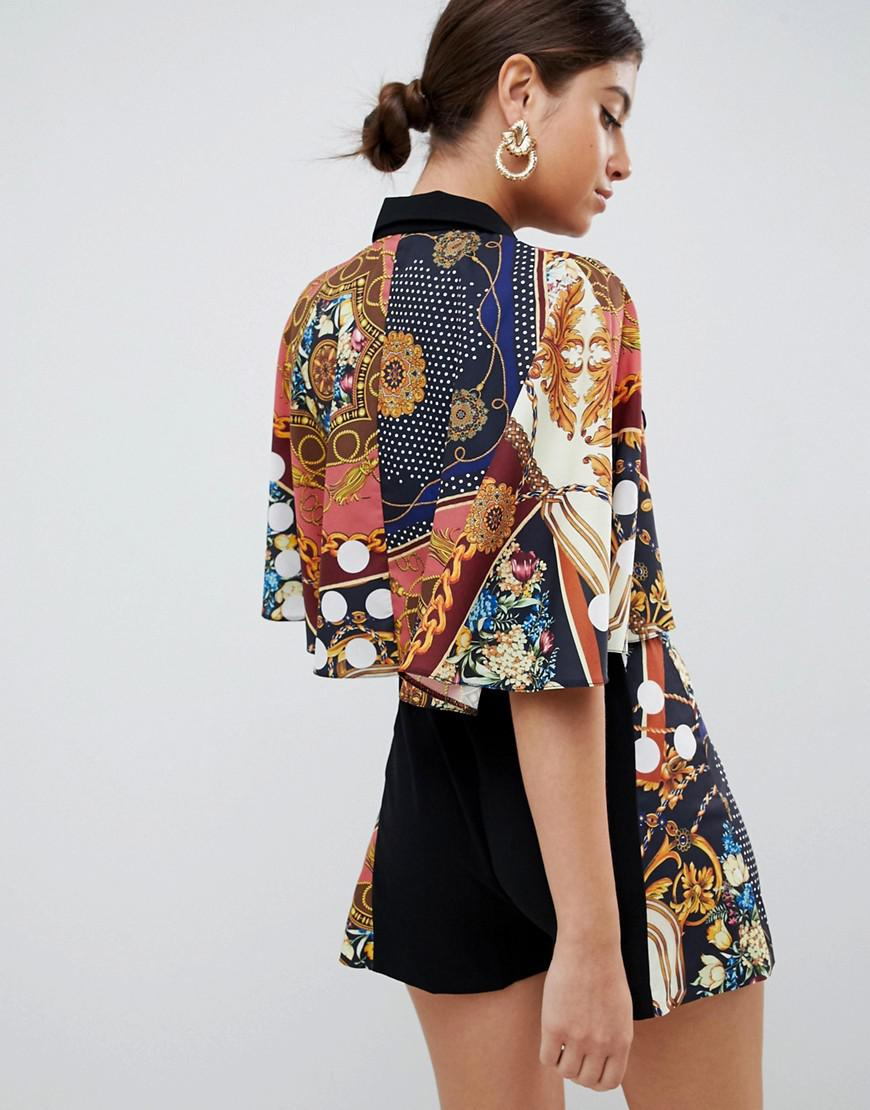 154f6ba943b Lyst - ASOS Romper With Cape And Scarf Print Detail in Black
