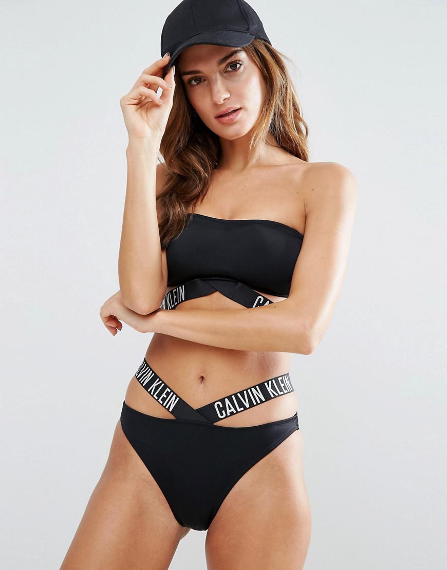 20a5f4b83268f Calvin Klein Logo Strap Bikini Bottom in Black - Lyst