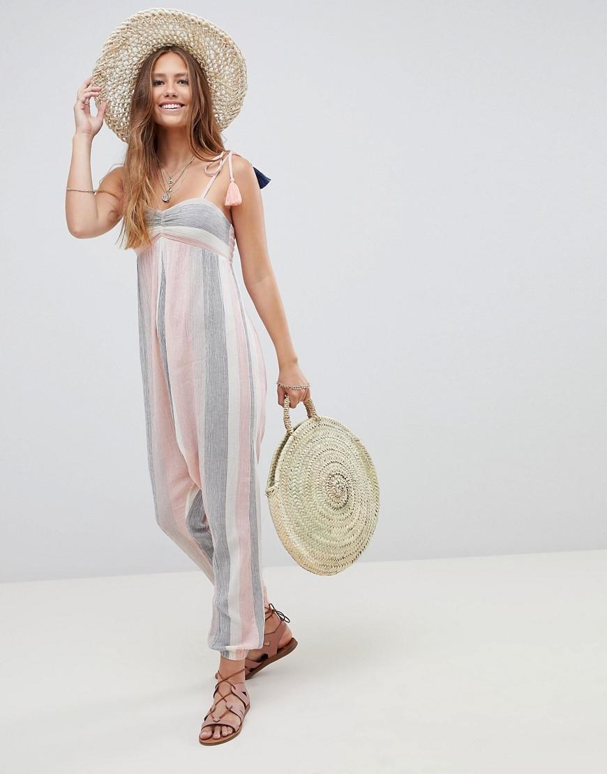 49e60ea4b1e3 Lyst - ASOS Beach Hareem Jumpsuit In Pastel Stripe With Tassel Ties