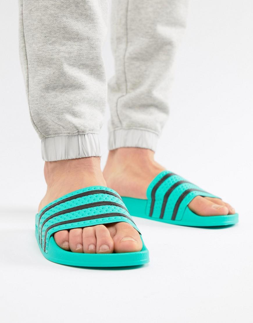 Lyst - adidas Originals Adilette Slides in Green for Men - Save 27% 81fd1cb1a