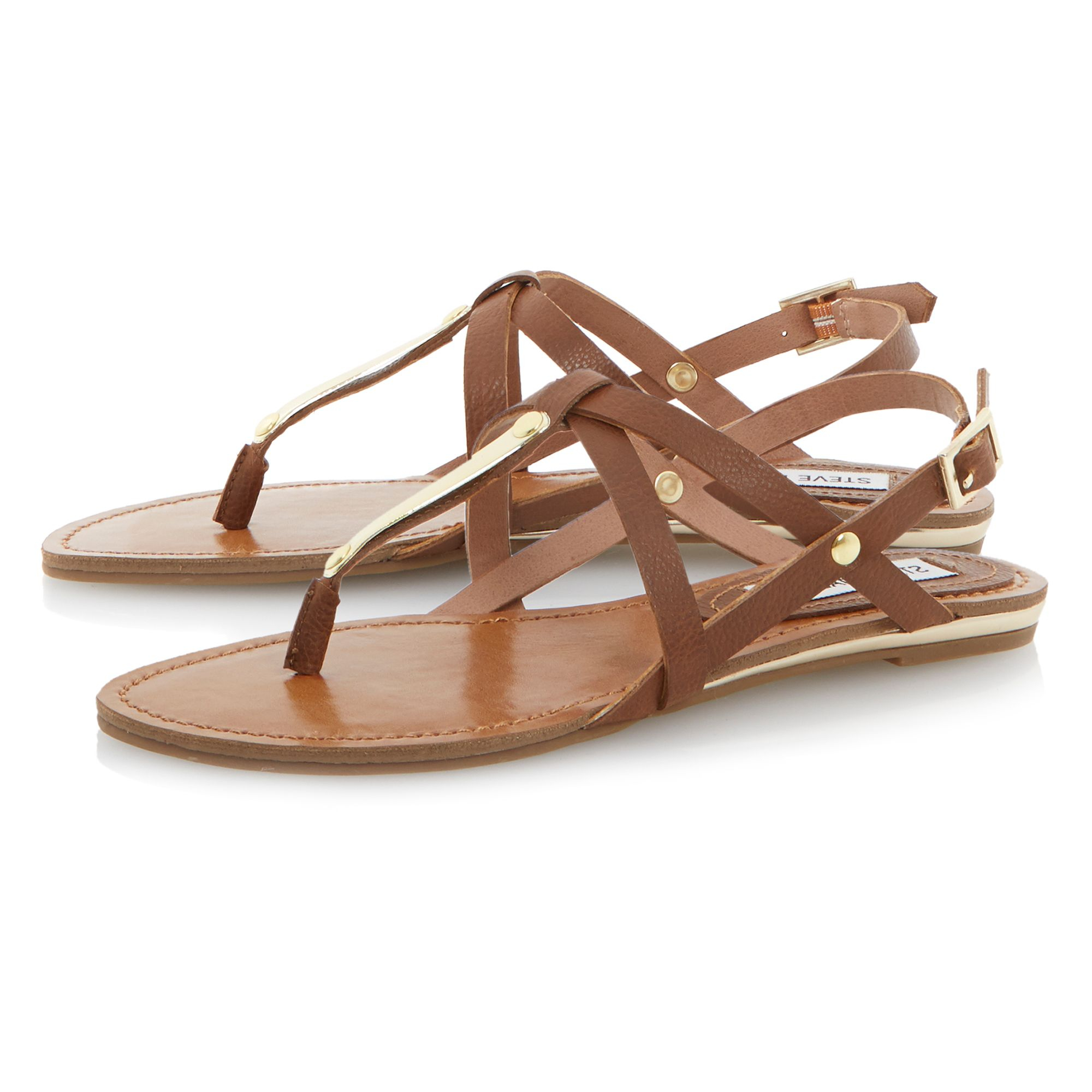 Steve madden junyaa flat sandals in brown lyst for Steve madden home designs