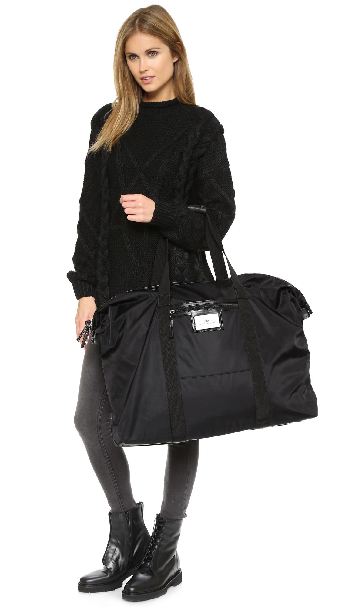 day birger et mikkelsen day gweneth weekend bag black in black lyst. Black Bedroom Furniture Sets. Home Design Ideas