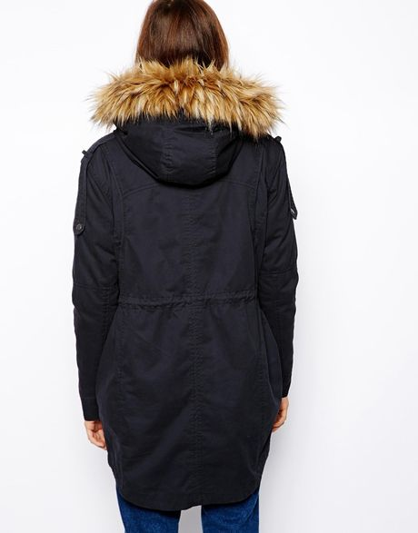 RENA-W by MACKAGE is a duffle style, below the knee length, black rabbit fur-lined parka. Navy dyed Finnish raccoon fur trim at hood. Drawstring waist and shirttail hem provides adjustable ciproprescription.ga: $1,