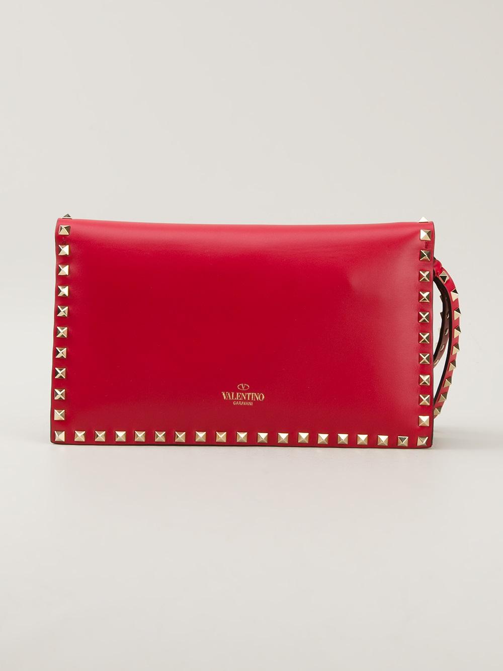 Lyst Valentino Rockstud Clutch In Red