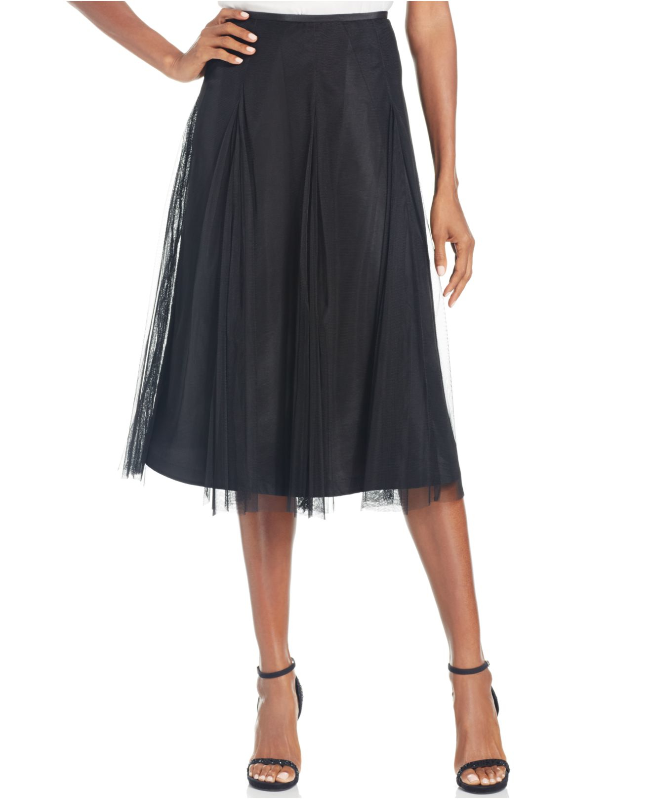 Long Tea Length Pleated Skirt. Longer length black pleated skirt has a comfy elasticized waistband. Easy-to-wear woven georgette lined skirt features a floaty design and crisp pleating.