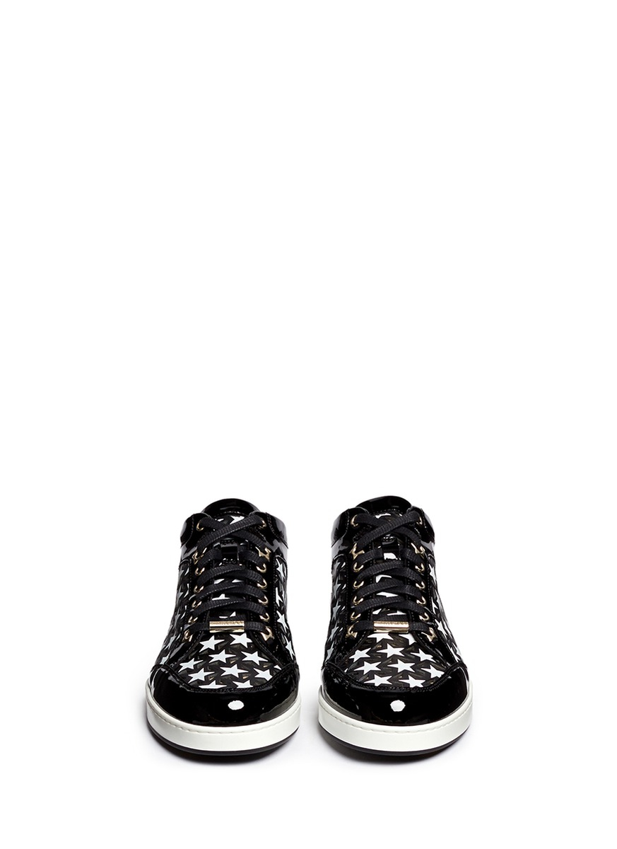 a1ff8e18396c ... ireland lyst jimmy choo miami star perforated patent leather sneakers  in black 38ac1 eb604