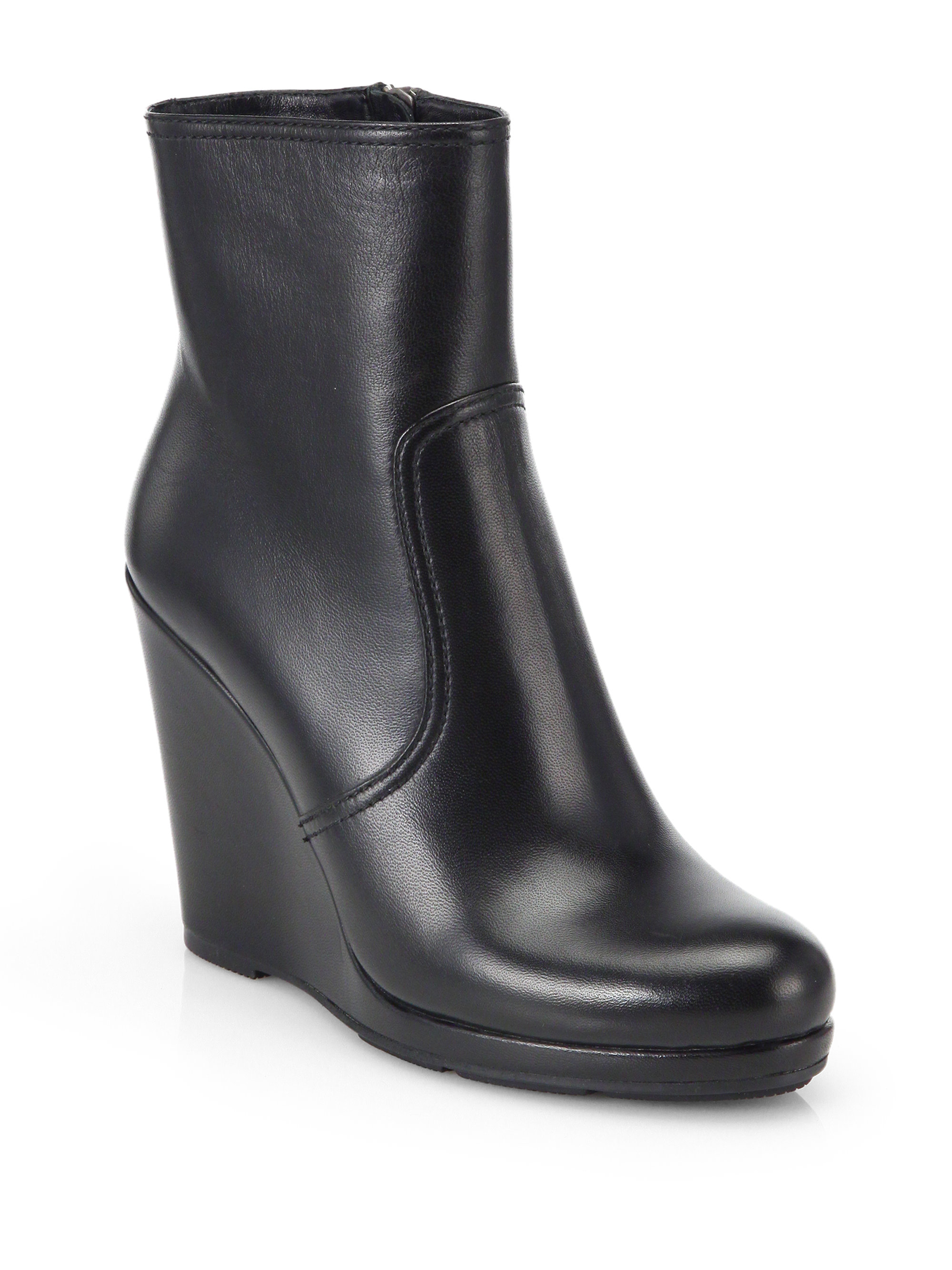 4980759b47f Lyst - Prada Leather Wedge Ankle Boots in Black