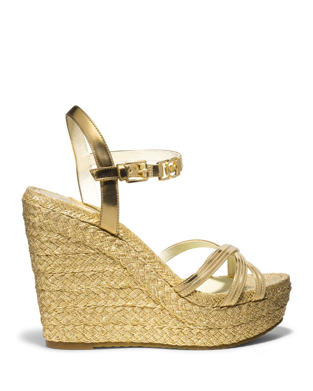 8c3347f5c61 Lyst - MICHAEL Michael Kors Cicely Metallic Wedge Sandal in Metallic