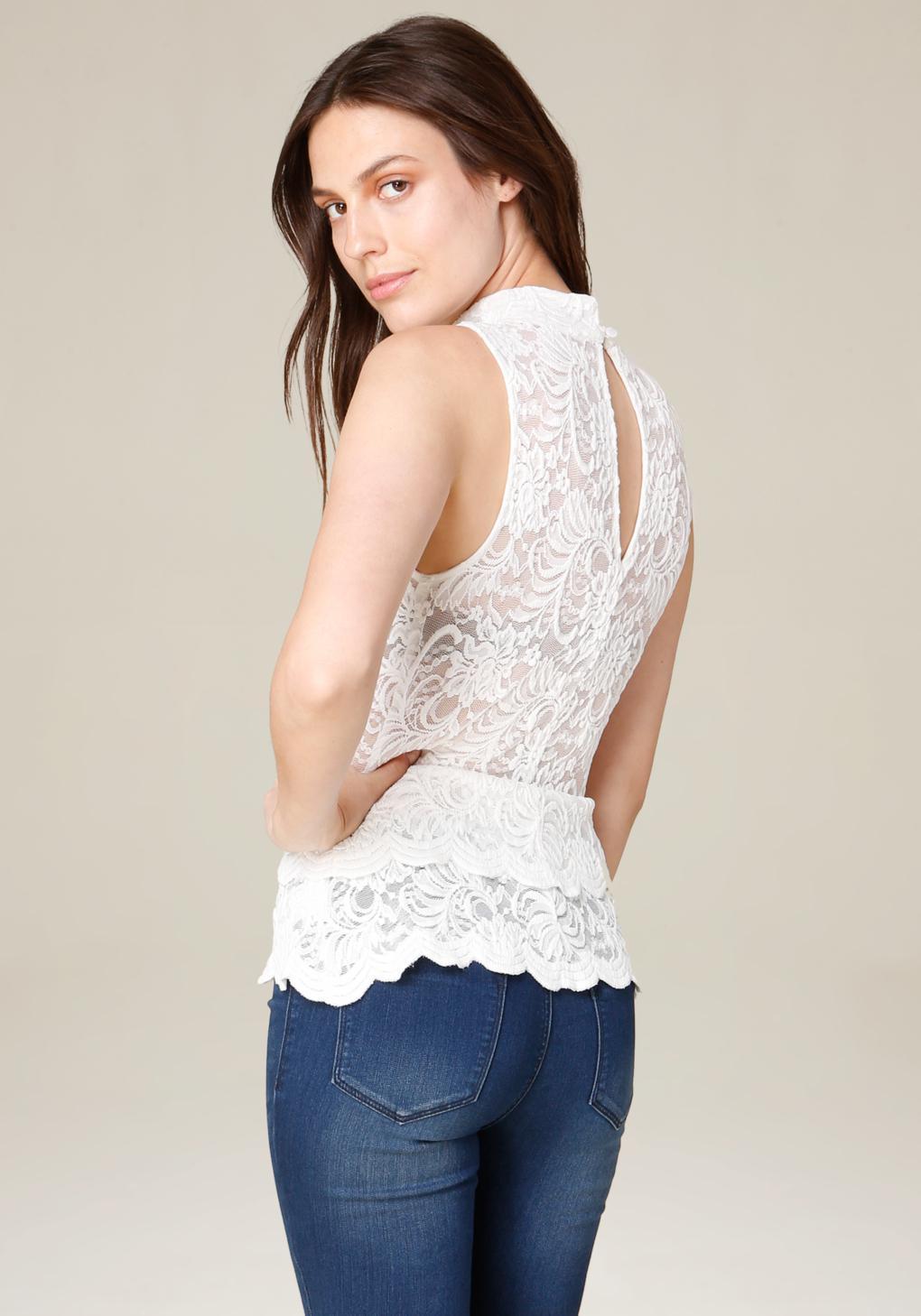 b2476dea7460d1 Lyst - Bebe Lace Mock Neck Peplum Top in White
