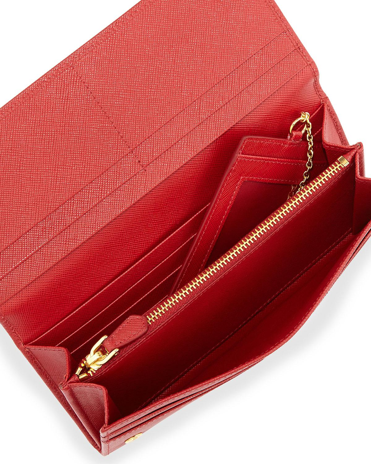 0d4455e2cd2a ... switzerland lyst prada saffiano continental flap wallet in red save  10.13698630136986 181ae 043b1