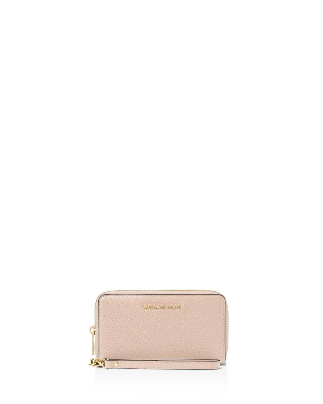 4cedbf64d1fc MICHAEL Michael Kors. Women's Pink Flat Multi-function Large Leather Smartphone  Wristlet