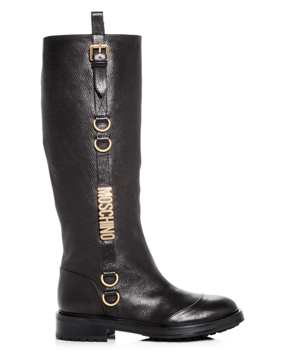 393718b6280 Lyst - Moschino Women s Logo Leather Riding Boots in Black - Save 44%