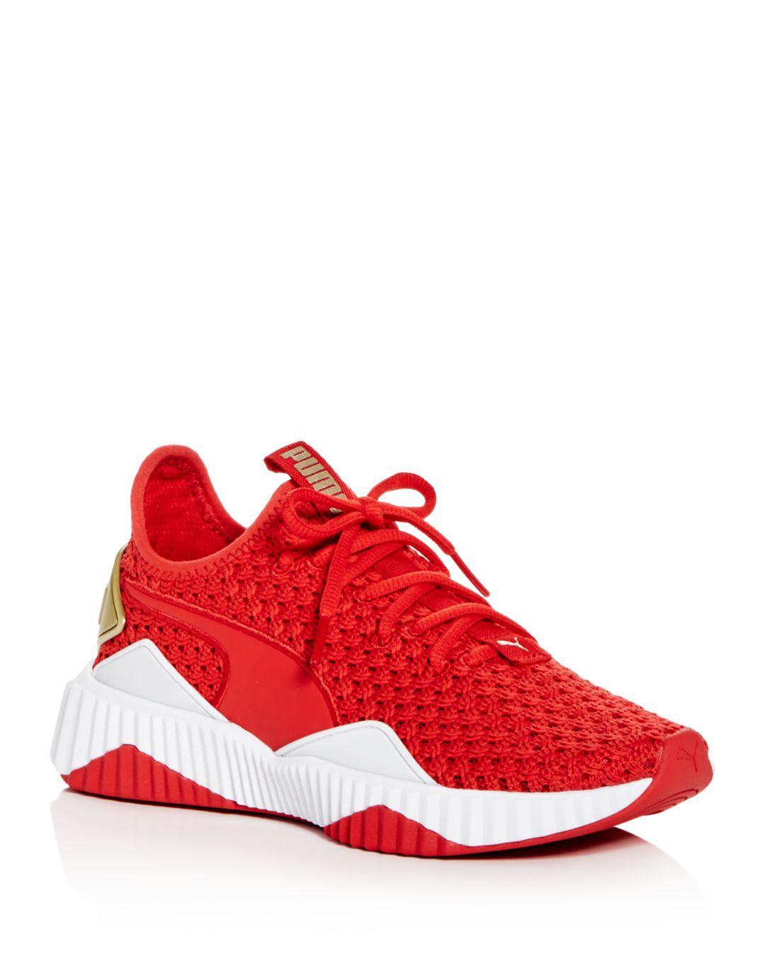 73b8b44226b617 Lyst - PUMA Women s Defy Varsity Knit Lace Up Sneakers in Red