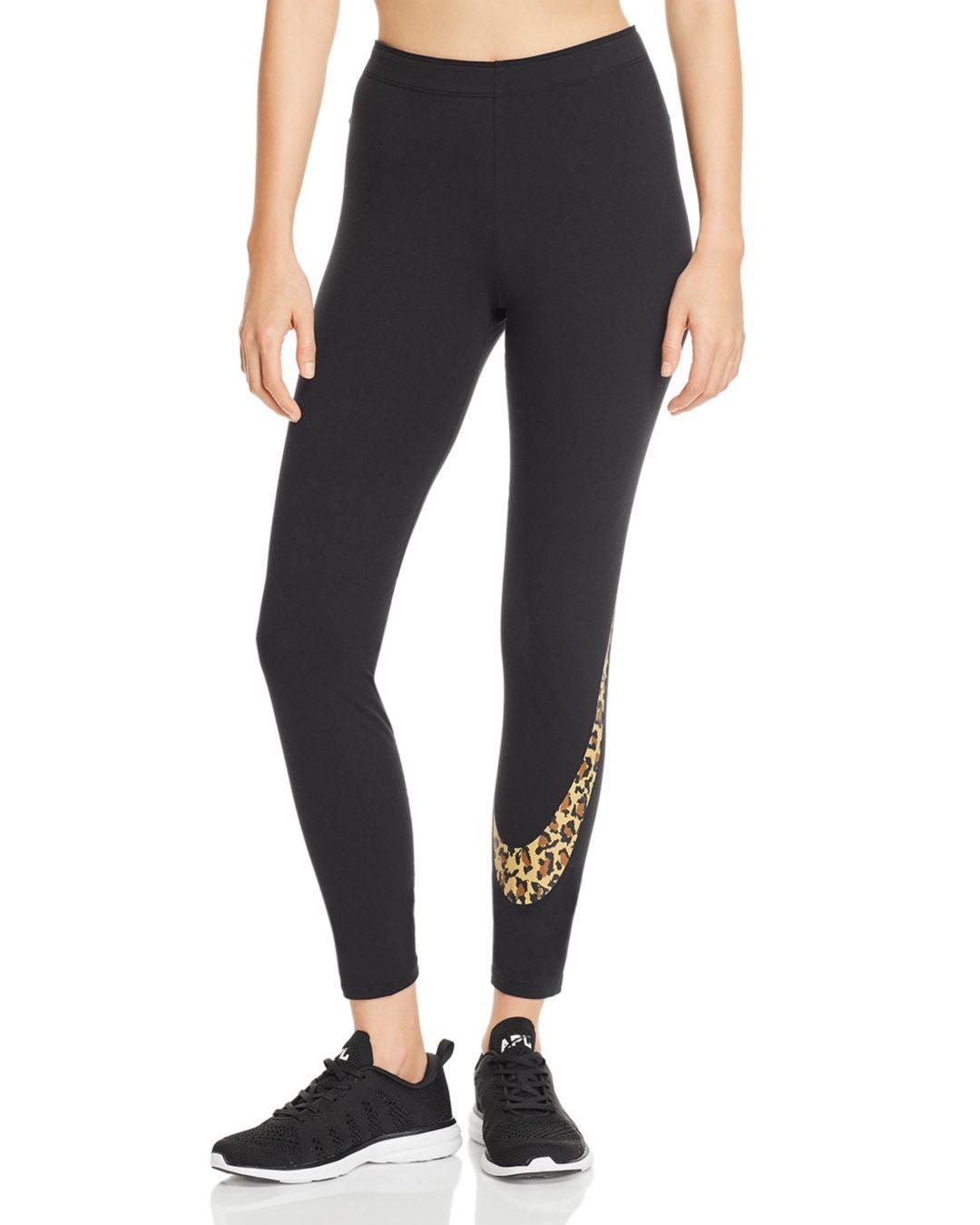 2fde78c9e3ad3d Nike Leopard Logo Leggings in Black - Lyst