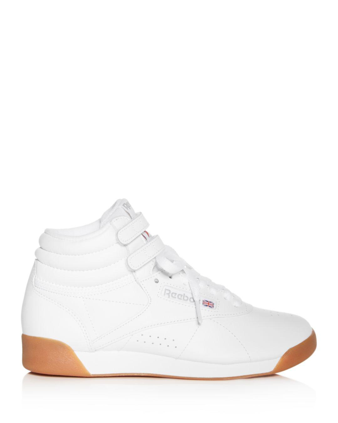 ed3d76a8dea Lyst - Reebok Women s Freestyle Leather High Top Sneakers in White